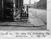 SK378865B, Man marking Ordnance Survey minor control revision point with an arrow in 1940s Sheffield
