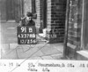 SK378891B, Man marking Ordnance Survey minor control revision point with an arrow in 1940s Sheffield
