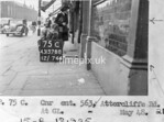 SK378875C, Man marking Ordnance Survey minor control revision point with an arrow in 1940s Sheffield