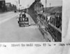 SK378819A, Man marking Ordnance Survey minor control revision point with an arrow in 1940s Sheffield