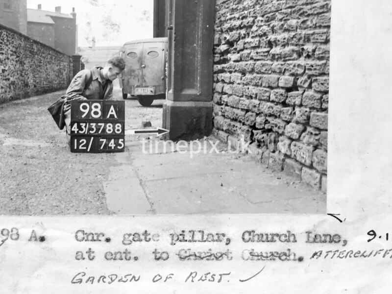 SK378898A, Man marking Ordnance Survey minor control revision point with an arrow in 1940s Sheffield