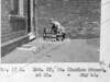 SK378857L, Man marking Ordnance Survey minor control revision point with an arrow in 1940s Sheffield