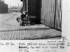SK378827L, Man marking Ordnance Survey minor control revision point with an arrow in 1940s Sheffield
