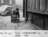 SK378860A, Man marking Ordnance Survey minor control revision point with an arrow in 1940s Sheffield