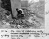 SK378822A, Man marking Ordnance Survey minor control revision point with an arrow in 1940s Sheffield