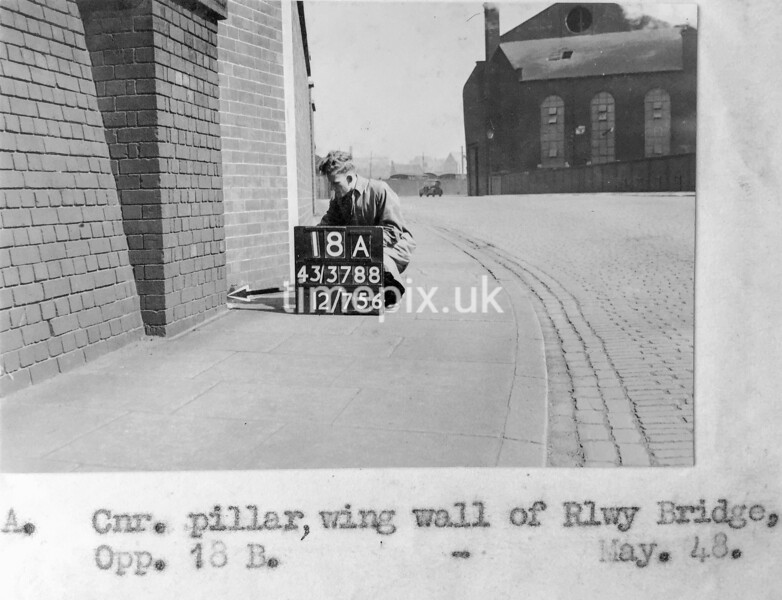 SK378818A, Man marking Ordnance Survey minor control revision point with an arrow in 1940s Sheffield