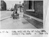 SK378808A, Man marking Ordnance Survey minor control revision point with an arrow in 1940s Sheffield