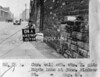 SK378804A, Man marking Ordnance Survey minor control revision point with an arrow in 1940s Sheffield