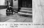 SK378841A, Man marking Ordnance Survey minor control revision point with an arrow in 1940s Sheffield