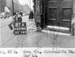 SK378887A, Man marking Ordnance Survey minor control revision point with an arrow in 1940s Sheffield