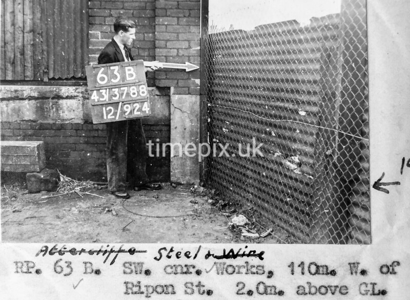 SK378863B, Man marking Ordnance Survey minor control revision point with an arrow in 1940s Sheffield