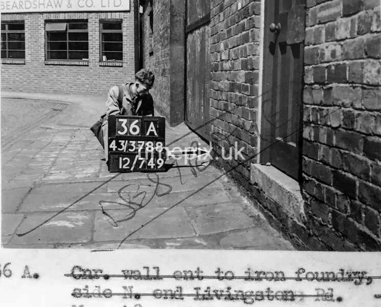 SK378836A, Man marking Ordnance Survey minor control revision point with an arrow in 1940s Sheffield