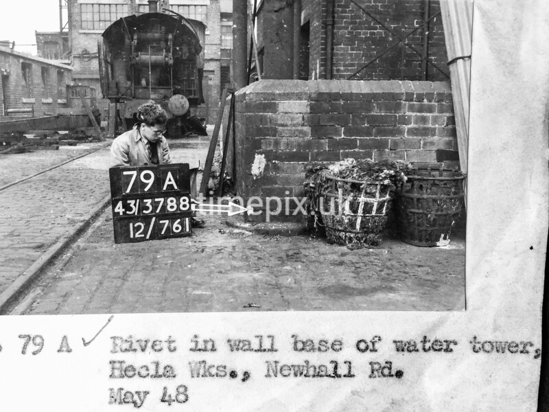 SK378879A, Man marking Ordnance Survey minor control revision point with an arrow in 1940s Sheffield