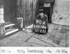 SK378890A, Man marking Ordnance Survey minor control revision point with an arrow in 1940s Sheffield