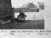 SK378866A, Man marking Ordnance Survey minor control revision point with an arrow in 1940s Sheffield