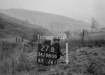 SD980627B, Man marking Ordnance Survey minor control revision point with an arrow in 1950s