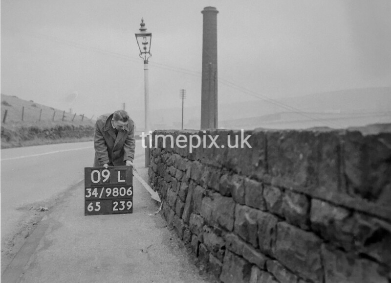 SD980609L, Man marking Ordnance Survey minor control revision point with an arrow in 1950s