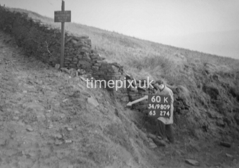 SD980960K, Man marking Ordnance Survey minor control revision point with an arrow in 1950s