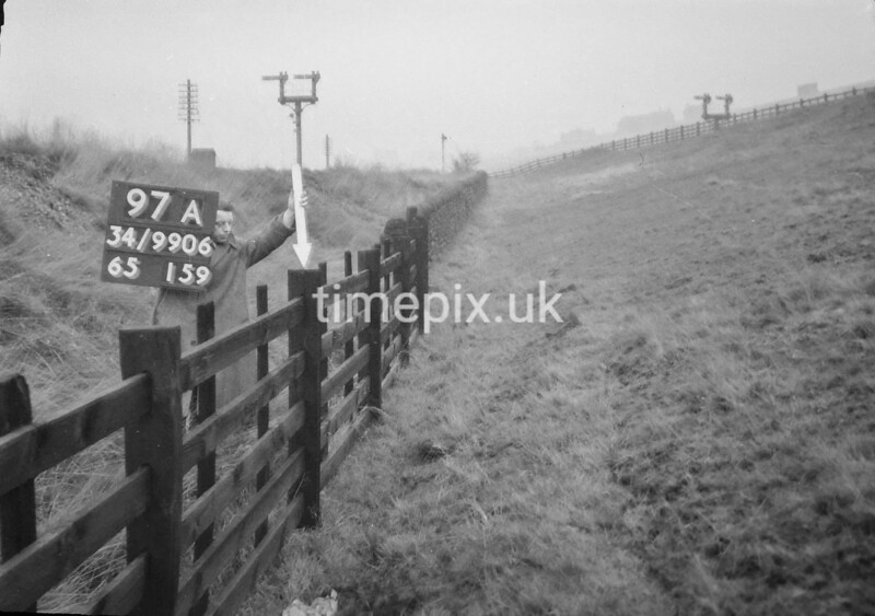 SD990697A1, Man marking Ordnance Survey minor control revision point with an arrow in 1950s