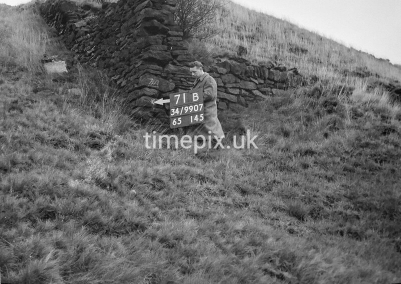 SD990771B1, Man marking Ordnance Survey minor control revision point with an arrow in 1950s