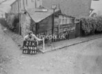 SD980821K, Man marking Ordnance Survey minor control revision point with an arrow in 1950s