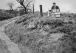 SD980865A, Man marking Ordnance Survey minor control revision point with an arrow in 1950s