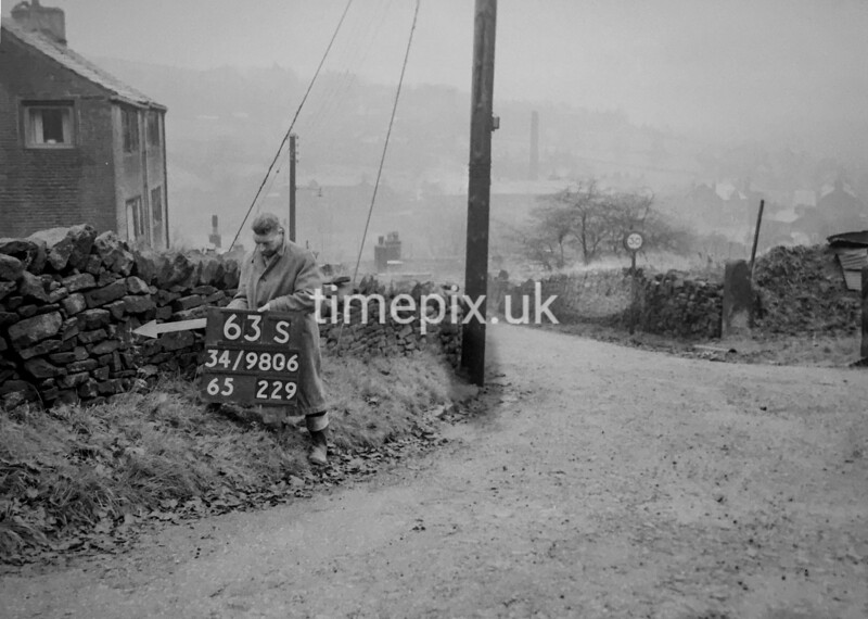 SD980663S, Man marking Ordnance Survey minor control revision point with an arrow in 1950s