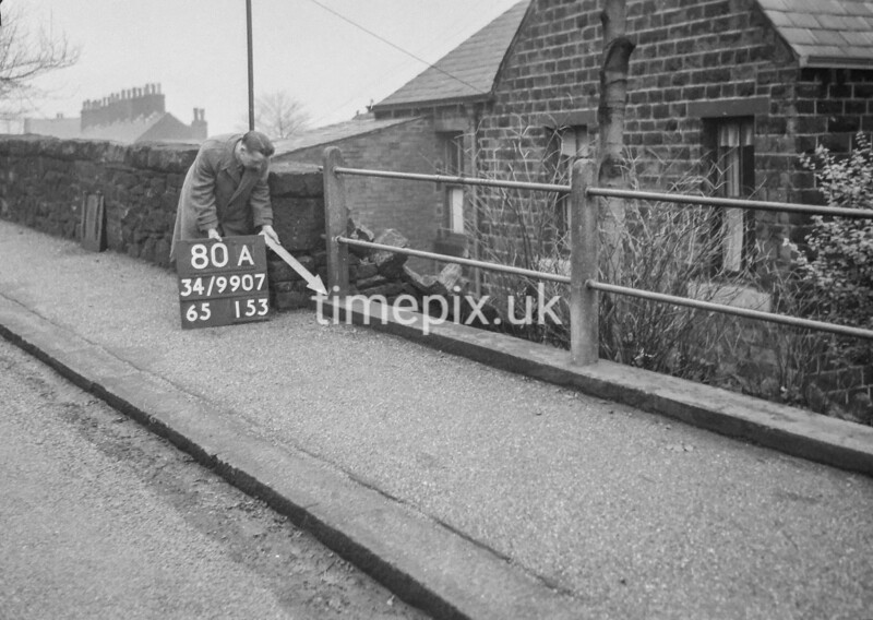 SD990780A2, Man marking Ordnance Survey minor control revision point with an arrow in 1950s