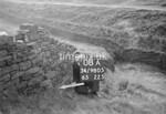 SD980508A, Man marking Ordnance Survey minor control revision point with an arrow in 1950s