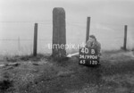 SD990640B2, Man marking Ordnance Survey minor control revision point with an arrow in 1950s