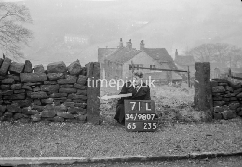 SD980771L, Man marking Ordnance Survey minor control revision point with an arrow in 1950s