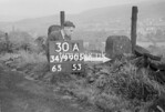SD990530A, Man marking Ordnance Survey minor control revision point with an arrow in 1950s