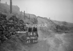 SD980714B, Man marking Ordnance Survey minor control revision point with an arrow in 1950s