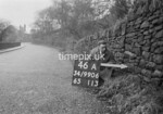 SD990646A1, Man marking Ordnance Survey minor control revision point with an arrow in 1950s