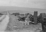 SD990896A, Man marking Ordnance Survey minor control revision point with an arrow in 1950s