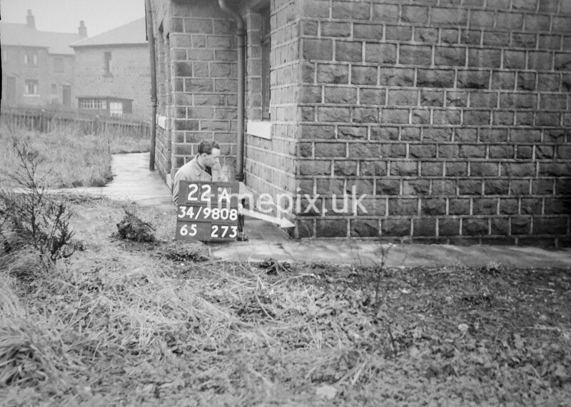 SD980822A, Man marking Ordnance Survey minor control revision point with an arrow in 1950s