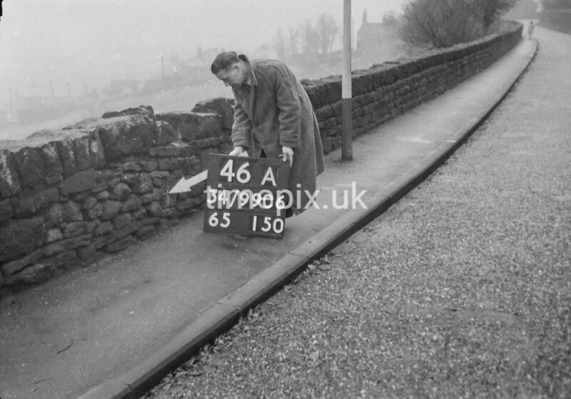SD990646A2, Man marking Ordnance Survey minor control revision point with an arrow in 1950s