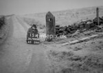 SD980815A, Man marking Ordnance Survey minor control revision point with an arrow in 1950s