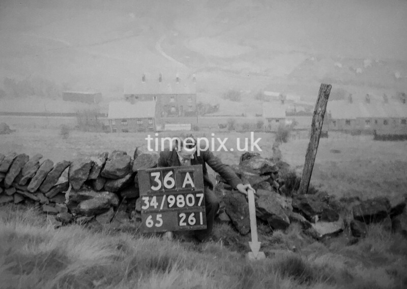SD980736A, Man marking Ordnance Survey minor control revision point with an arrow in 1950s