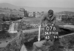 SD990807B, Man marking Ordnance Survey minor control revision point with an arrow in 1950s