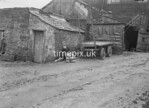 SD980990A, Man marking Ordnance Survey minor control revision point with an arrow in 1950s