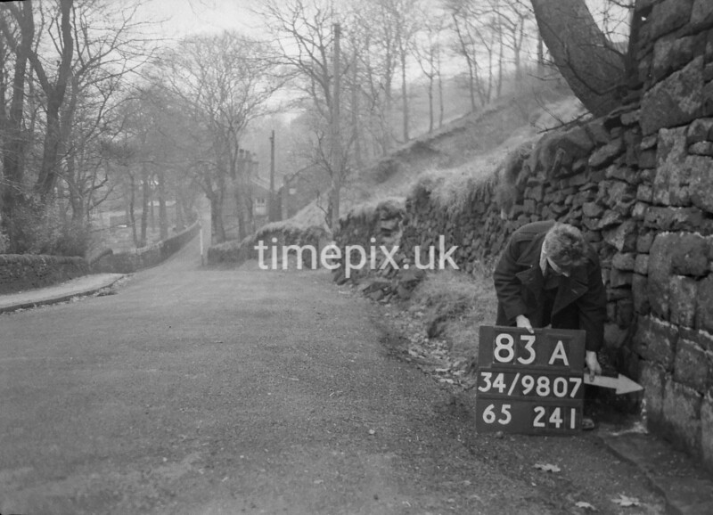 SD980783A, Man marking Ordnance Survey minor control revision point with an arrow in 1950s