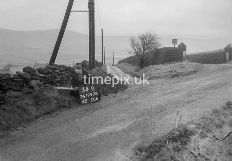 SD990834B1, Man marking Ordnance Survey minor control revision point with an arrow in 1950s