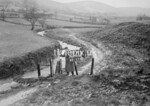 SD990818A, Man marking Ordnance Survey minor control revision point with an arrow in 1950s