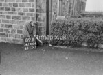 SD980689B, Man marking Ordnance Survey minor control revision point with an arrow in 1950s