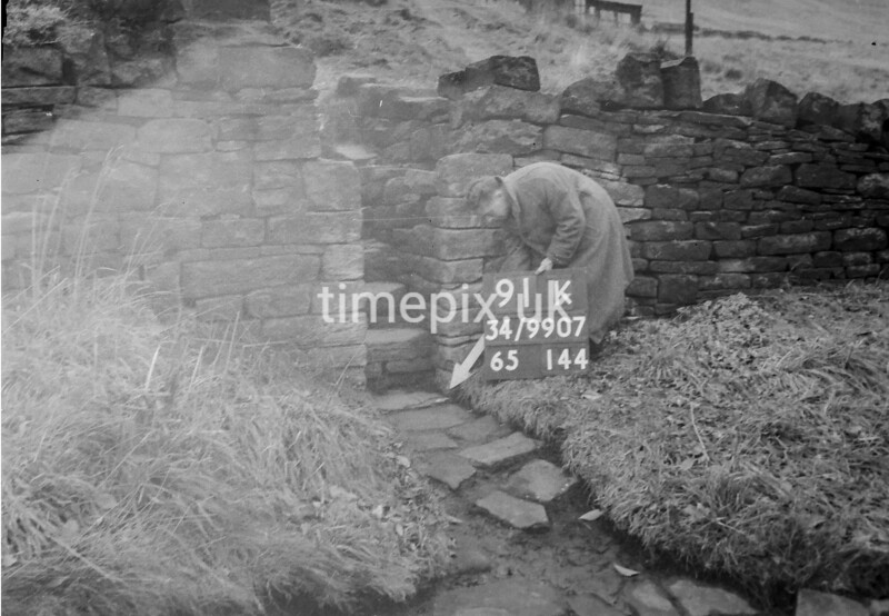 SD990791K, Man marking Ordnance Survey minor control revision point with an arrow in 1950s