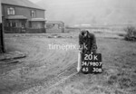 SD980720K, Man marking Ordnance Survey minor control revision point with an arrow in 1950s