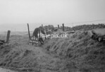SD990869A, Man marking Ordnance Survey minor control revision point with an arrow in 1950s