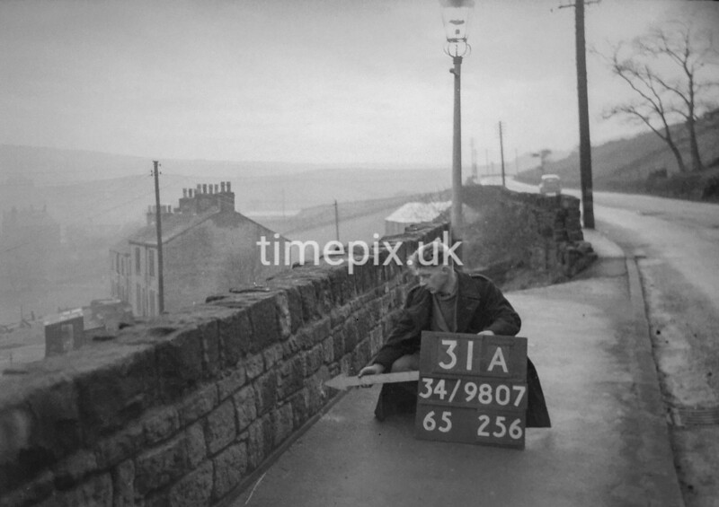 SD980731A, Man marking Ordnance Survey minor control revision point with an arrow in 1950s