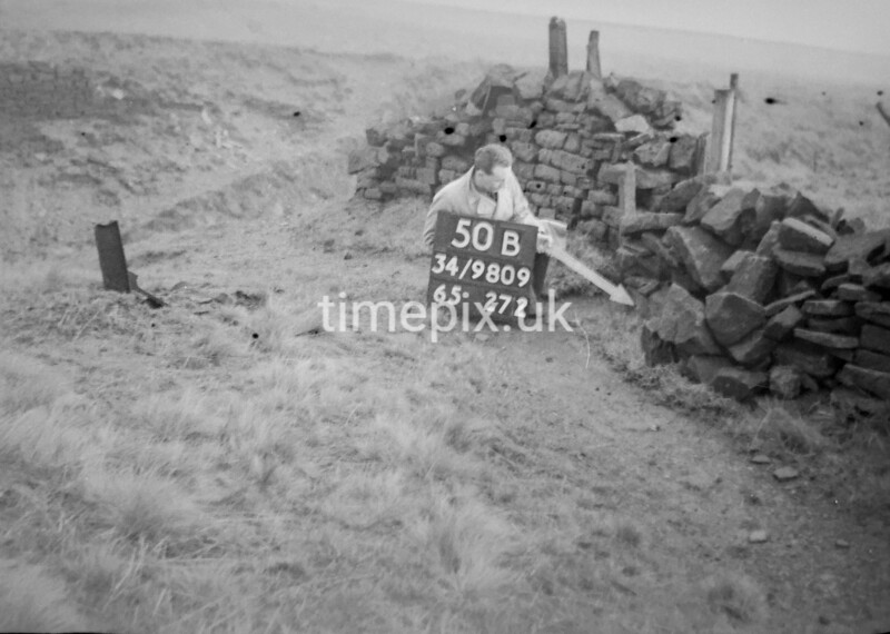 SD980950B, Man marking Ordnance Survey minor control revision point with an arrow in 1950s